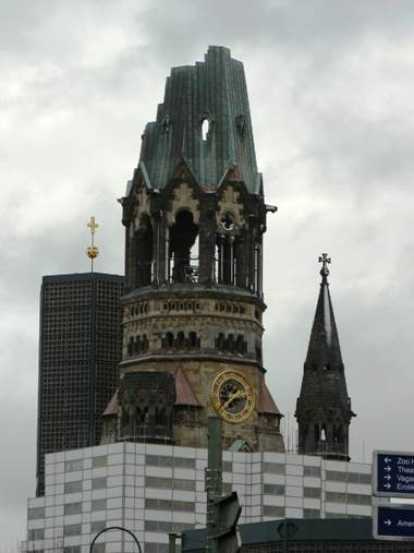 The Kaiser Wilhelm Memorial Church on the Kurfürstendamm; the church was badly damaged in a 1943 bombing, and the partial ruin has always been a powerful image
